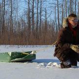 Bob Wright hauls wood through the snow.