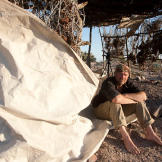 Les Stroud with shelter and a sail salvaged from a boat on Tiburon Island.