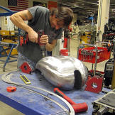 Rick Petko works on the gas tank for Orange County Choppers' Hard Rock