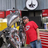 Paul Teutul Jr. checks out the progress on the FIST Bike. Weather impa