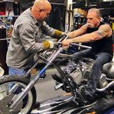 Mike Ammirati and Senior position the Hard Rock Bike's handlebars.