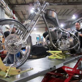 Joe Puliafico helps Paulie with the FIST bike's fender. With its rever