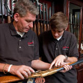 Rich and Kurt look over a fine presentation Model 1992 Winchester.
