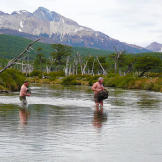 Stripped to their skivvies, the pair wade through a frigid river with their clothes high and dry. Brief pain is much better than the threat of hypothermia that comes with soaked clothing.