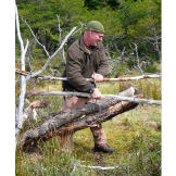 Dave uses a pair of heavy logs as the weighted striking force in a spiked deadfall beaver trap.