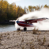 Jim catches a little water as he touches down on a remote, wilderness riverbed.  Landing on sandbars, glaciers and ridge tops is Jim's specialty and a major source of income.