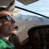 Pilot John Ponts in the cockpit of his Cessna 207 during one of his far northern runs for Era Alaska.