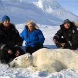 David Attenborough, Dr. Jon Aars and Magnus Andersen of the Norwegian Polar Institute with an anaesthetized polar bear, Svalbard, Norway.