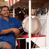 An employee of Gallery 63 since it opened, Delfino Ramos came on as temporary help, but his infectious smile, perpetual good attitude and undeniable talent led Paul to hire him, despite not having an opening at the time.
