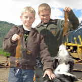 Hudson and Hunter Hoffman with freshly-caught squirrels that they'll skin and roast on their own.