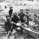 A mining crew displays a large gold nugget recovered from one of their sluices. Such finds were extremely rare and most miners were lucky to find a few ounces of hard-won dust.