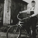 John shows off the bike he bought in 1933 with his earnings from deliv