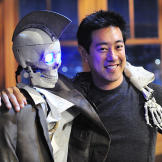 Grant Imahara poses with Geoff Peterson, the robot skeleton sidekick h