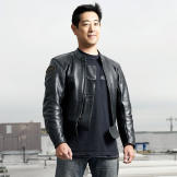 Grant Imahara poses atop M5 for a Discovery Channel photo shoot in Aug
