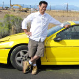 Grant Imahara poses with the remote-controlled car he built to test wh