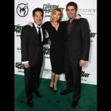 Grant Imahara, Kari Byron and Tory Belleci pose for pictures on the gr
