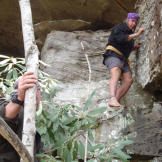Cody explores along a limestone wall for a good overnight shelter. The