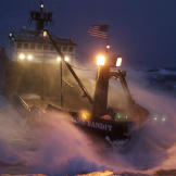 The Time Bandit powers through heavy seas — with her sodium high