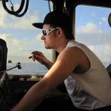 Captain Elliot Neese at the wheel of the Ramblin' Rose.