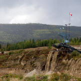 At a claim along the road from Dawson City, a massive wash plant proce