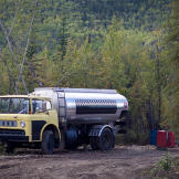 The fuel truck from Dawson stops by to fill up the claim's fuel storage drums. Expenses for diesel - to power both machines and the generator - typically run around $1,000 a day. Gold's not the only commodity that's gone up in price.