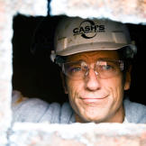 Mike Rowe peers out at the lucky photographer from the barge he was he