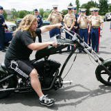Mikey Teutul drives the Comanche Bike at a 2006 OCC cook-out with serv