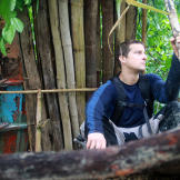 On an island in the Malay Archipelago  Bear Grylls sits by his shelter