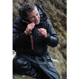 "Bear Grylls snacks on a small trout during his Iceland adventure. It's only 130 calories, but ""every little bit helps."""