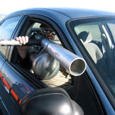 In order to test whether tossing a cup out a speeding car's window can