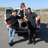 Grant, Tory and Kari posed with the ball-chucker they built to test wh