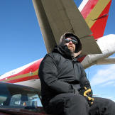 Jamie Hyneman sits below the MythBusters' tornado simulator, a 747 tha