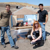 Tory Belleci, Kari Byron and Grant Imahara show off the miniature kitc