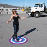 Kari Byron shows off the saucy target painted just for Buster in the &