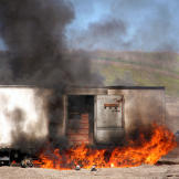 At the hands of Kari Byron, Tory Belleci and Grant Imahara, a wine truck — filled, yes, with a lot of wine and champagne — explodes at the Alameda Bomb Range. (Look away if you're a wine fan. Look away.)
