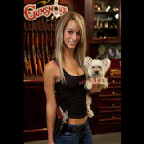 Paige poses in the Gunsmoke shop with two of her favorites: her dog Ma