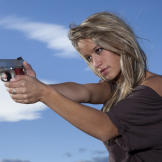 Paige takes aim with the Defender, a lighter, more compact model of th