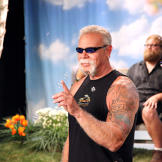 Paul Teutul Sr. faces off against bubbles as Mikey relaxes in the back