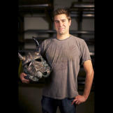 Tory Belleci poses with the customized Stormtrooper helmet he created