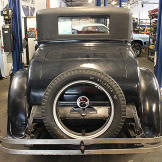 Back bumper of 1926 Velie before renovations begin. Trunk closed.