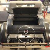 Back bumper of 1926 Velie before renovations begin. Trunk open.