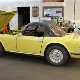 The TR6 arrives. Profile drivers side