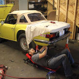 Keith working on the TR6.