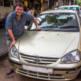 Mike Brewer posing with his second car purchase, a Tata Indigo Marina.