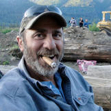 Good-natured Chris Doumitt likes nothing better than a fine cigar with