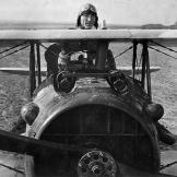 Great American and Great Ace Eddie Rickenbacker with his SPAD in France right before the end of the First World War.