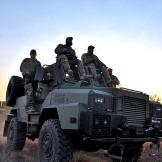 Biggs (Navy SEAL fmr.), Oz (Green Beret), Saw (Navy SEAL fmr.), Rob (Navy SEAL ret.) traveling on Reva vehicle on patrol.