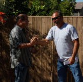 Buyers Doug Hopkins and Ed Rosenberg shake hands in a rare moment of friendliness.