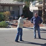 John Ray points an accusing finger toward fellow buyer Doug Hopkins.