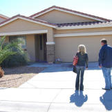 Doug Hopkins and Shari Pozniak admire the curb appeal of this auction home.